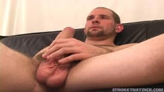 A gay guy sits on the couch for a wank