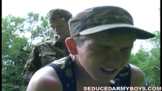 Two young army cadets enjoy outdoor sex