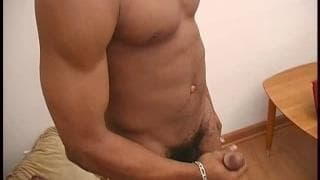 This muscular black guy jerks off