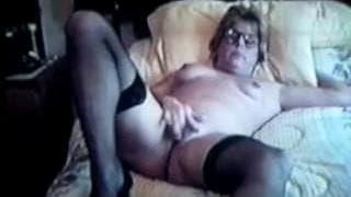 A mature woman masturbates at home