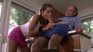 This brunette is happy to suck a mature cock