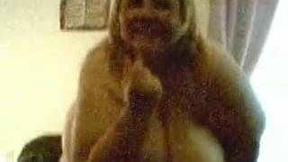 A super fat mature woman dances on camera