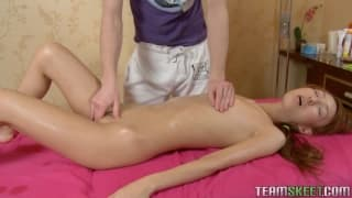 A pretty redhead enjoys a sensual massage
