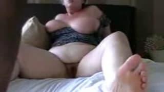 Mature BBW sits on a big black dick