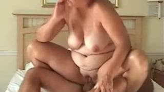 A chubby couple have sex in bed together