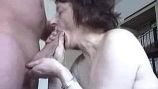 A mature woman sucks cock deeply