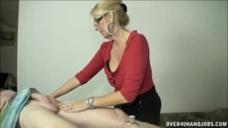 A blonde milf who gives a good handjob