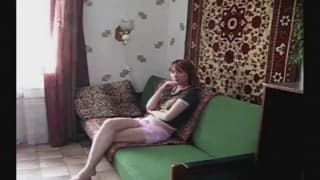 Young stud fucks redhead on the couch