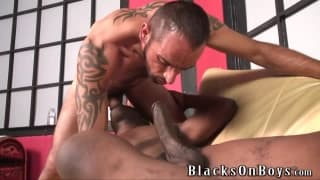 A bearded guy enjoys a big black dick