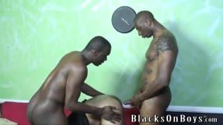 Two black men enjoy a tight white ass