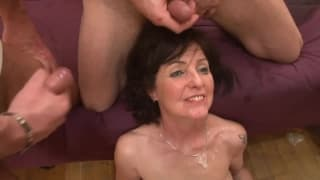 This brunette milf gets a double penetration
