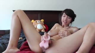 Horny Asian babe has new plastic friend