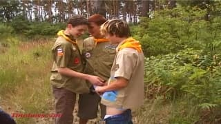 Young boys playing boyscouts and having fun