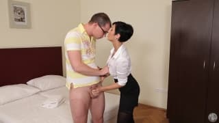 Black haired woman in skirt giving a blowjob