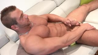 This muscular guy has a big hard cock to wank