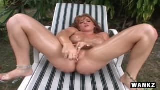 A redhead milf loves to fuck herself with oil