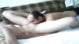Older guy banging younger girl on the sofa