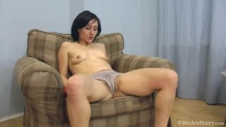 Using a dildo in her hairy pussy