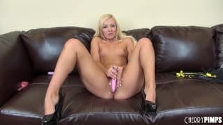 Aaliyah Love opens up wide on the sofa