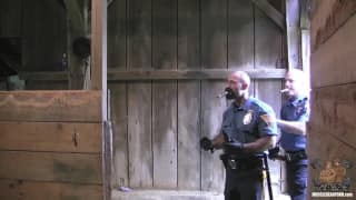 Two gay police men fuck in a barn