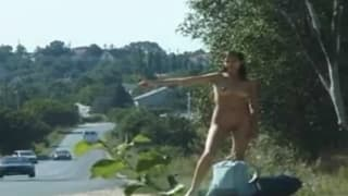 This brunette gets naked and hitch-hikes