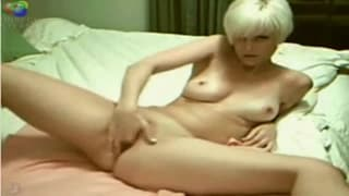 Cute blonde plays with herself on webcam