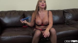 Ava Devine spreads her legs on the sofa