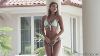 Sexy brunette touching herself outside