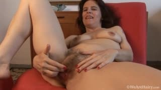 Marie plays with her hairy pussy