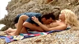 Hot blonde has sex on the beach