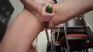 A hairy pussy is fucked with a cucumber
