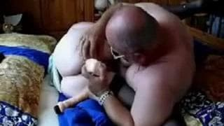 This granddad uses a dildo in her pussy