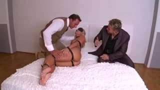 Two guys tie her up and give her a double