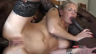 A slutty blonde has big black dicks in her