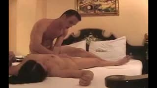 An Asian cougar enjoys his cock in bed