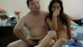 An Asian couple who enjoy making love in bed