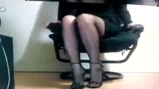 This teasing slut plays with herself at work