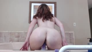 Brunette masturbating in the jet bath