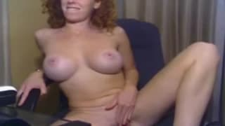A milf with big tits touches herself eagerly