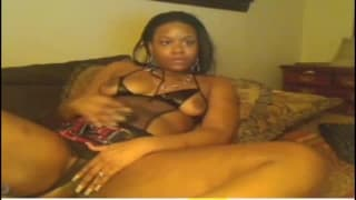 Sexy black woman fingers herself