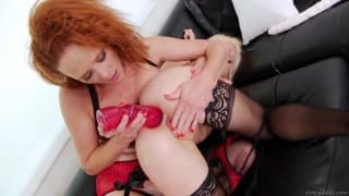 A redhead and dildos make sparks in this clip