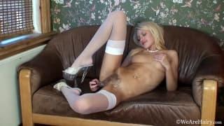 Blond with hairy pussy masturbates with dildo
