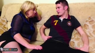 Mature woman fucks young guy on the sofa