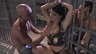 Jenny takes on two guys in a jail fuck