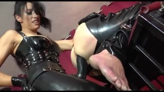 Brunette dominatrix fucks his ass with a toy