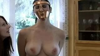 She puts a muzzle on her and then masturbates