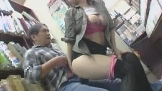 Horny Asian babe sucks his dick in a library