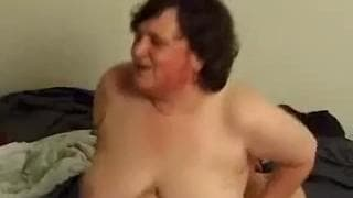 Mature couple get each other horny in bed