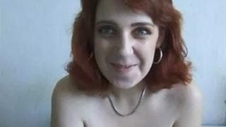 He caresses her big natural tits on camera