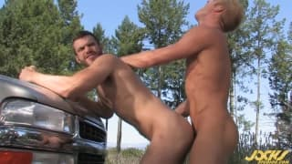 Two friends fucking outdoors by the car